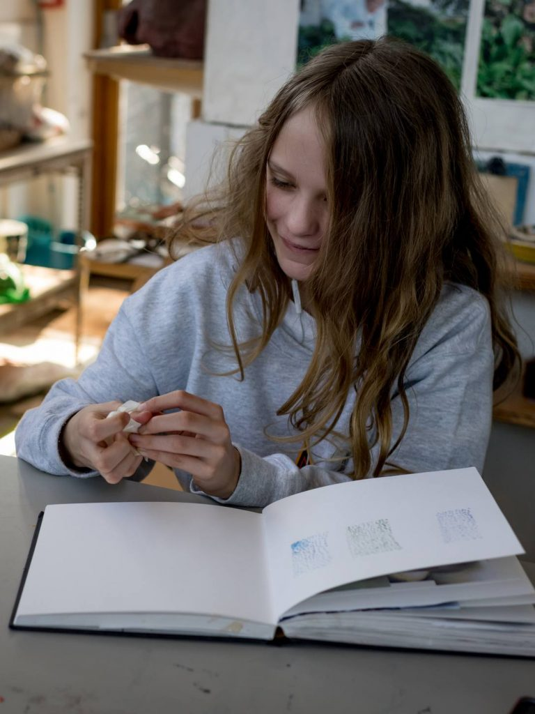 young girl with a sketch book
