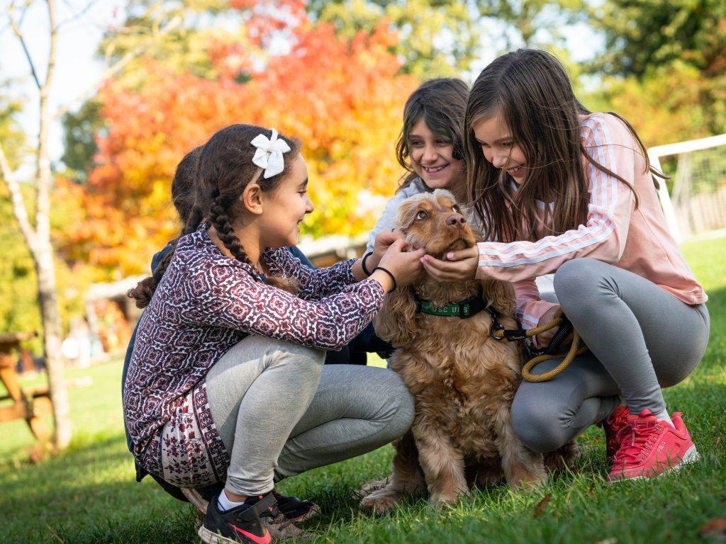 Lower School students with school dog, Alfie