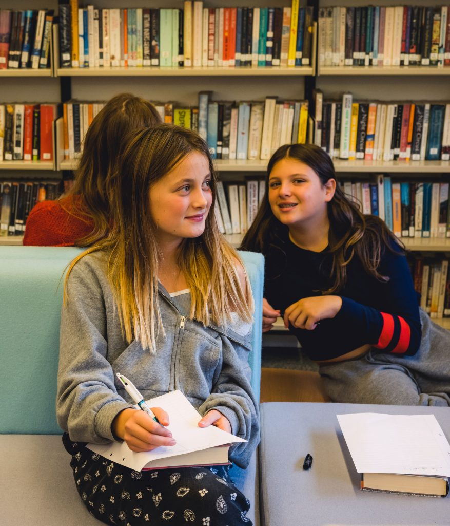 Upper School students in the library