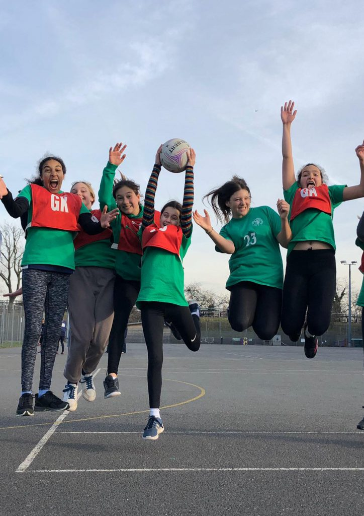 Netball team celebrate a win