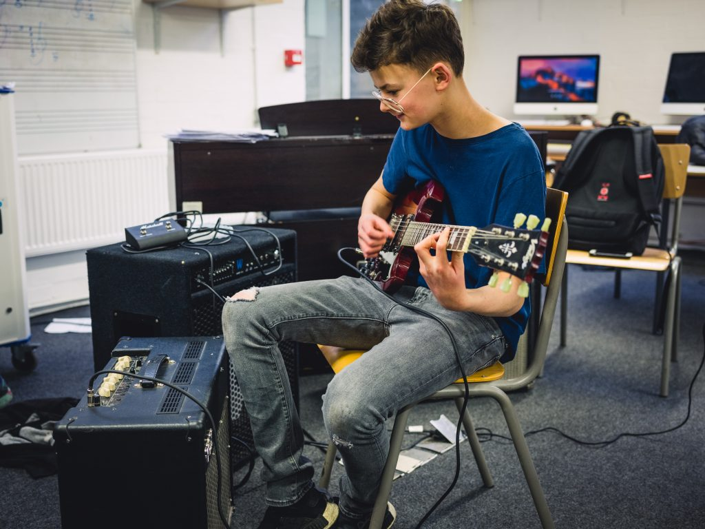 Y11 student plays guitar