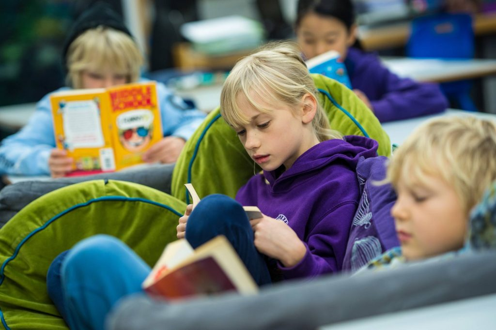 Year 3 student reading in class