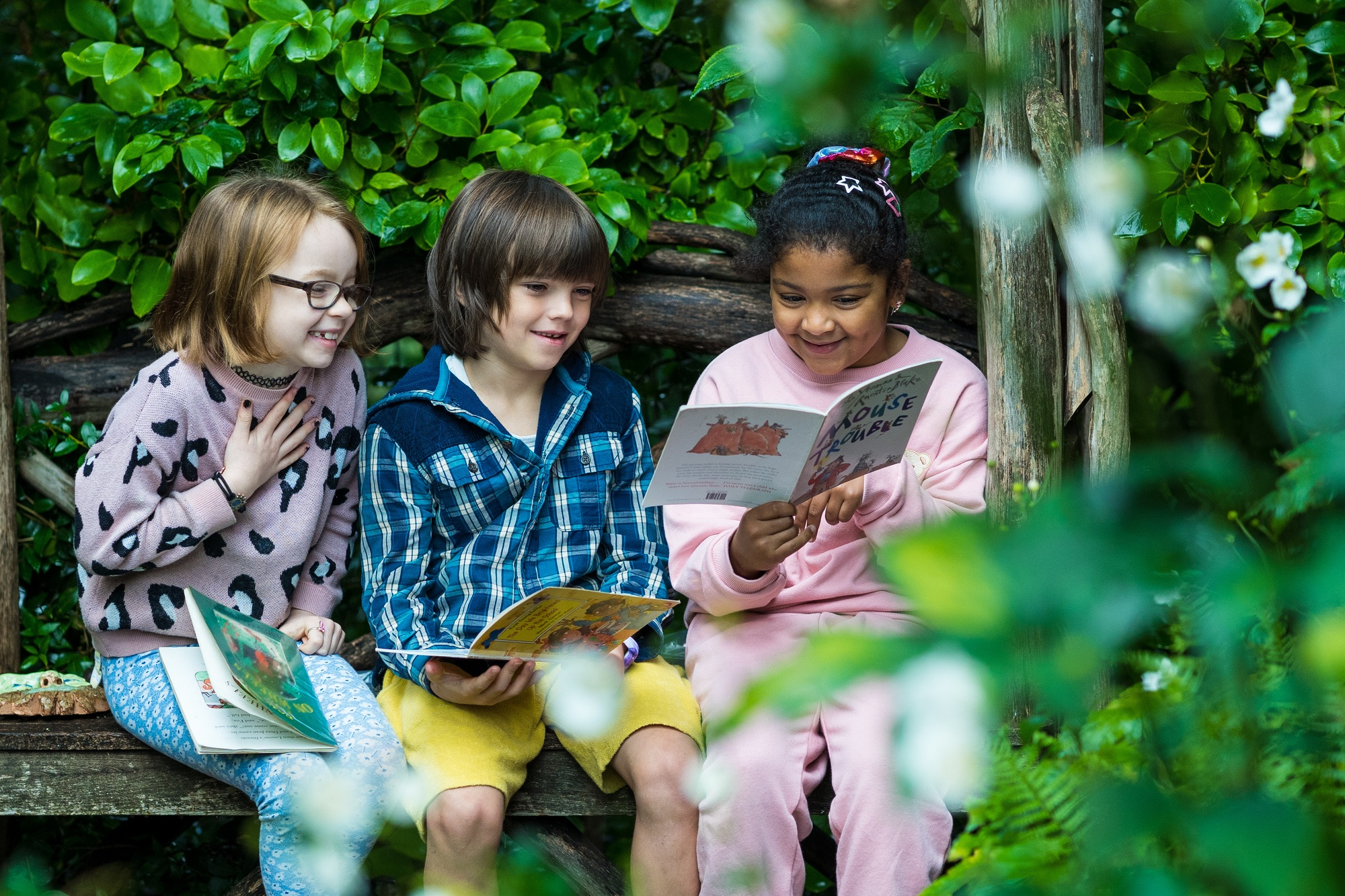 Year 3 students reading outdoors