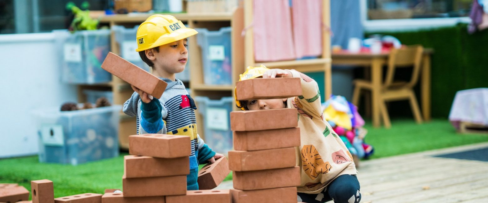 Reception students building with blocks