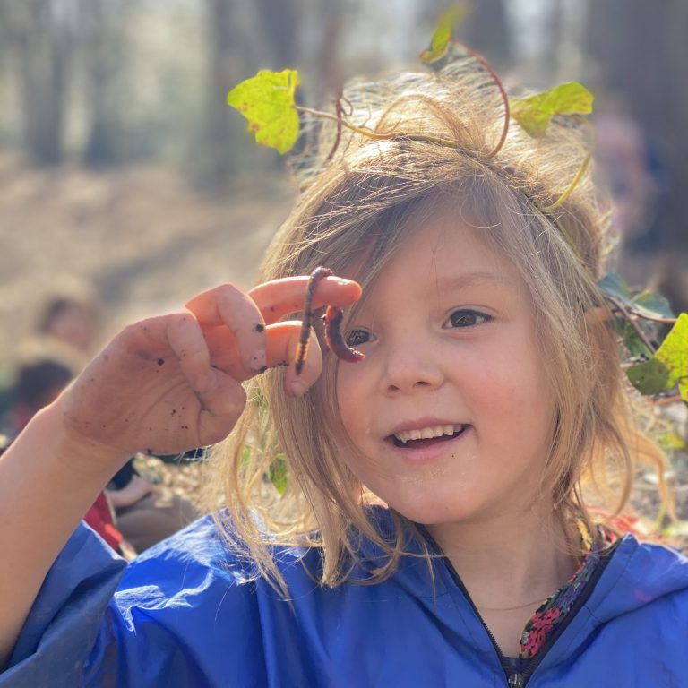 Forest school - student holding a worm